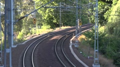 Roslagsbanan train travels north from University station, passes a steep curve Stock Footage