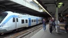 SL shuttle train arrives to platform of Stockholm C station Stock Footage