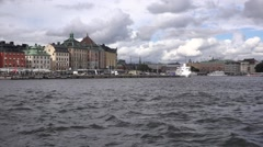 Gamla Stan and Blasieholmen quays with moored boats seen from moving ferry Stock Footage