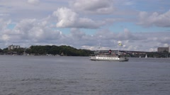 Old ferry in grey livery runs between Kungsholmen and Sodermalm Stock Footage