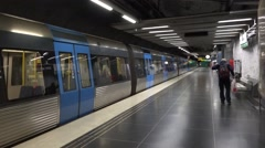 Stockholm Tunnelbana C20 stock train departs from a station platform Stock Footage