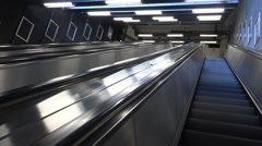 Tunnelbana station escalator running uphill Stock Footage