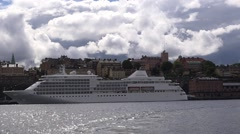 Cruise liner moored at the Sodermalm embankment dock Stock Footage