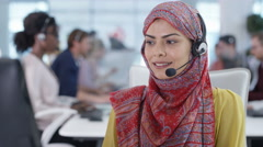 4K Portrait smiling call center worker wearing a hijab Stock Footage