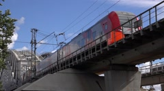 Lastochka special express train enters an elevated track from the bridge Stock Footage