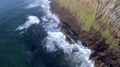 Aerial of waves crashing against the rocks Stock Footage