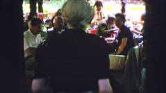 1963: everyone is having a great time at the restaurant and beer garden today. Stock Footage