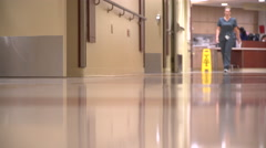 Two nurses walk down the hall in a modern hospital Stock Footage