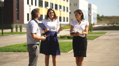 Three colleagues are discussing business in the innovation city Stock Footage