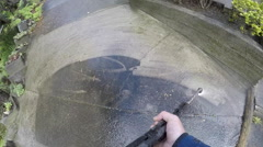 Water blasting moss off concrete path, point of view (POV) Stock Footage