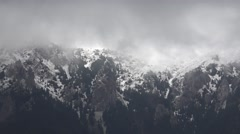 4K Amazing fog motion on mountain peak covered by snow in winter cold season day Stock Footage