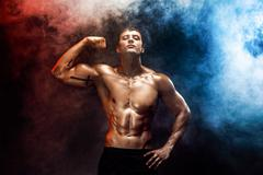 Strong bodybuilder man with perfect abs, shoulders, biceps, triceps, chest Stock Photos