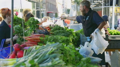 NEW YORK/USA - August 03, 2016: Clerk with Union Square Greenmarket customers Stock Footage
