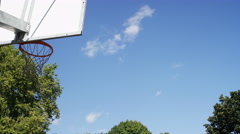 Basketball shot from a distance and scores, in slow motion Stock Footage