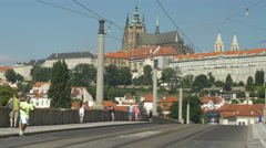 Tram on Manes Bridge and St Vitus Cathedral Stock Footage