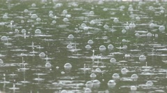 4K Bubble effect of rain fall water drop splash on lake surface rainfall impact Stock Footage