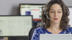 Female customer service representative working in an office Stock Footage