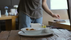 Professional photographer shooting food in restaurant and use tablet Stock Footage