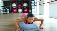 Woman fitness workout wellness concept. Athlete girl does exercises on the gym Stock Footage