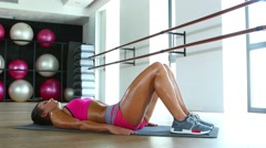 Young attractive blonde woman exercising on a mat. Dolly shot Stock Footage