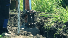 Digger  Excavator digging and excavating Stock Footage
