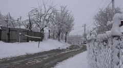 4K Beautiful country car road covered by snow rural village house in winter day Stock Footage