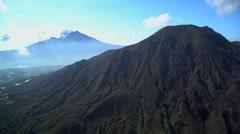 Aerial view Mt Batur Mt Abang Mt Agung Volcano Bali Indonesia Stock Footage