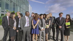 Portrait of cheerful diverse business team with blue sky and white clouds Stock Footage