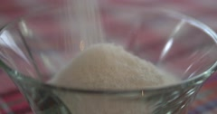 Pouring coconut powder in bowl Stock Footage