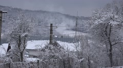 4K Aerial view traditional house chimney smoke in cold winter day snowy forest Stock Footage