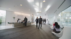 Diverse group of city business people in reception area of large modern Stock Footage