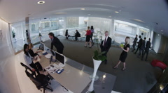 CCTV camera view of business people in reception area Stock Footage