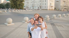 Happy smiling family does selfie. people are photographed on a cell phone Stock Footage