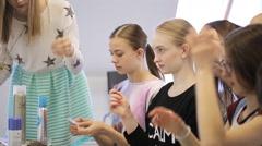 In model school women are making bundle Stock Footage