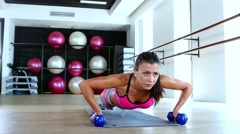 Woman at gym push up push-up workout exercise with dumbbells. Dolly shot Stock Footage
