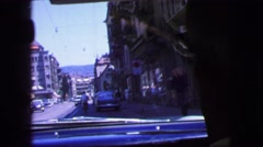 1963: street car and busy city street as seen through the front window  Stock Footage