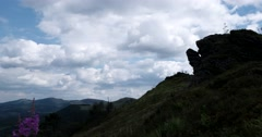 Photographer on the Top of the Mountain With Running Clouds Over the Mountain Stock Footage