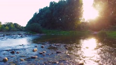 Fly through a beautiful River Landscape, lens flares sunlight shot Stock Footage