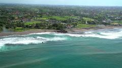 Aerial coastal Resorts and Plantation rice fields Bali Indonesia Southeast Asia Stock Footage