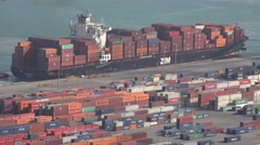 4K Aerial view cargo ship unload container in busy port shipyard good store day Stock Footage