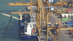 4K Aerial view crane machine load cargo ship in container port industrial work Stock Footage