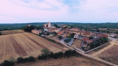 Aerial shot of a small old village / town in spain on a sunny day with clear sky Stock Footage
