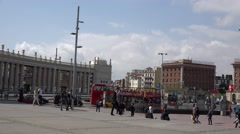 4K Pan right follow touristic red bus in Spanish Square Barcelona downtown icon Stock Footage