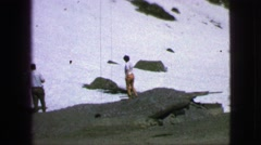1963: snow in summer an old family film up in the peaks of a mountain range Stock Footage