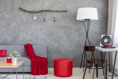 Dominant role of grey and red in stylish interior decor Stock Photos
