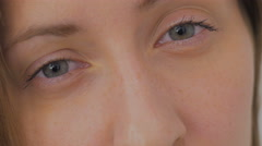 Big close up of young woman's eyes Stock Footage