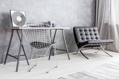 Ascetic but stylish decor of a modern apartment's office corner Stock Photos