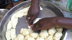 African woman knead dough - Dakar, Senegal Stock Footage