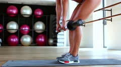 Athletic woman doing workout in gym Stock Footage
