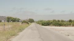 Lonely Vineyard Road Near Highway Stock Footage